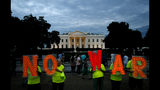 """Protesters hold signs spelling out, """"No War,"""" outside the White House, Thursday June 20, 2019, in Washington, after President Donald Trump tweeted that """"Iran made a very big mistake"""" by shooting down a U.S. surveillance drone over the Strait of Hormuz in Iran. (AP Photo/Jacquelyn Martin)"""