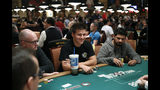 """Jeopardy!"" champion and professional sports gambler James Holzhauer, center, plays in a tournament at the World Series of Poker, Monday, June 24, 2019, in Las Vegas. (AP Photo/John Locher)"