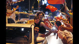 Supporters of Ekrem Imamoglu, the candidate of the secular opposition Republican People's Party, CHP, celebrate in central Istanbul, Sunday, June 23, 2019. In a blow to Turkish President Recep Tayyip Erdogan, Imamoglu declared victory in the Istanbul mayor's race for a second time Sunday after Binali Yildirim, the government-backed candidate conceded defeat in a high-stakes repeat election. (AP Photo/Lefteris Pitarakis)