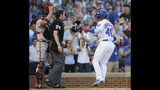 Chicago Cubs' Willson Contreras, right, yells at Atlanta Braves' Tyler Flowers, left, as he crosses the plate after hitting a home run as home plate umpire John Tumpane steps between the two during the second inning of a baseball game Monday, June 24, 2019, in Chicago. (AP Photo/Jim Young)