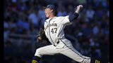 Michigan pitcher Tommy Henry (47) prepares to throw against Vanderbilt during the third inning in Game 1 of the NCAA College World Series baseball finals in Omaha, Neb., Monday, June 24, 2019. (AP Photo/Nati Harnik)