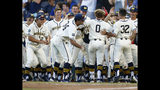 Michigan's Joe Donovan (0) celebrates with teammates after his home run against Vanderbilt during the eighth inning in Game 1 of the NCAA College World Series baseball finals in Omaha, Neb., Monday, June 24, 2019. (AP Photo/John Peterson)