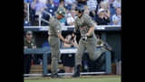 Vanderbilt right fielder JJ Bleday (51) is congratulated by head coach Tim Corbin as he heads for home plate after hitting a home run against Michigan during the inning in Game 1 of the NCAA College World Series baseball finals in Omaha, Neb., Monday, June 24, 2019. (AP Photo/Nati Harnik)