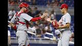 St. Louis Cardinals relief pitcher Jordan Hicks, right, and catcher Matt Wieters congratulate each other after they defeated the Miami Marlins in a baseball game, Monday, June 10, 2019, in Miami. (AP Photo/Wilfredo Lee)