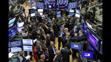 FILE - In this June 20, 2019, file photo traders gather at a post on the floor of the New York Stock Exchange as they wait for the Slack Technologies IPO to begin trading. Stocks are off to a mixed start on Wall Street on Monday, June 24, as gains for technology companies are offset by losses in health care and other sectors. (AP Photo/Richard Drew, File)