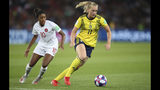 Sweden's Stina Blackstenius, right, is chased by Canada's Ashley Lawrence during the Women's World Cup round of 16 soccer match between Canada and Sweden at Parc des Princes in Paris, France, Monday, June 24, 2019. (AP Photo/Francisco Seco)