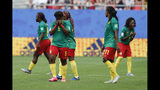 Cameron players react after a VAR decision that ruled out Cameroon's Ajara Nchout's goal for offside during the Women's World Cup round of 16 soccer match between England and Cameroon at the Stade du Hainaut stadium in Valenciennes, France, Sunday, June 23, 2019. (AP Photo/Michel Spingler)