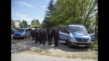 Police secure a street in Nossentiner Huette, eastern Germany on Monday, June 24, 2019 near the place where two German Eurofighter military planes crashed earlier today. (Jens Buettner/dpa via AP)