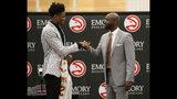 Atlanta Hawks first-round NBA draft pick Cam Reddish of Duke, left, speaks with head basketball coach Lloyd Pierce during a news conference Monday, June 24, 2019, in Atlanta. (AP Photo/John Bazemore)