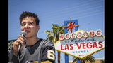 """FILE - In this May 2, 2019, file photo, """"Jeopardy!"""" sensation James Holzhauer speaks after being presented with a key to the Las Vegas Strip in front of the Welcome to Fabulous Las Vegas sign in Las Vegas. """"Jeopardy!"""" champion and professional sports gambler James Holzhauer is making his World Series of Poker debut in Las Vegas on Monday, June 24, 2019, with plans to donate half of his winnings to charity. (Caroline Brehman/Las Vegas Review-Journal via AP, File)"""