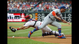 New York Mets' Pete Alonso, right, scores past Philadelphia Phillies catcher J.T. Realmuto on a double by Michael Conforto during the first inning of a baseball game, Monday, June 24, 2019, in Philadelphia. (AP Photo/Matt Slocum)