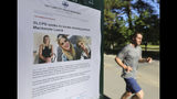 A joggers runs pass a poster of MacKenzie Luek at Liberty Park Monday, June 24, 2019, in Salt Lake City. Police and friends are investigating the disappearance of the 23-year-old University of Utah student, whose last communication with her family said she arrived at Salt Lake City International Airport on Monday, June 17. (AP Photo/Rick Bowmer)