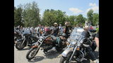 Motorcyclists attend the Blessing of the Bikes ceremony in Columbia, N.H. on Sunday, June 23, 2019. The long-planned ceremony for motorcycle enthusiasts became a scene of mourning and reflection as about 400 people paid tribute to seven bikers killed Saturday in a devastating collision with a pickup truck. (AP Photo/Lisa Rathke)