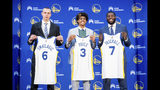 From left to right, Golden State Warriors NBA basketball draft picks Alen Smailagic, Jordan Poole and Eric Paschall display their jerseys during a media conference on Monday, June 24, 2019, in Oakland, Calif. (AP Photo/Noah Berger)