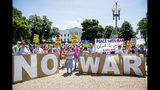 Members of the ANSWER Coalition hold an anti-war with Iran rally outside of the White House in Washington, Sunday, June 23, 2019. (AP Photo/Andrew Harnik)