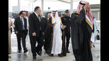 U.S. Secretary of State Mike Pompeo, centre left, walks with Saudi Foreign Minister Ibrahim Abdulaziz Al-Assaf, as Pompeo arrives in Jeddah, Saudi Arabia, Monday, June 24, 2019. Pompeo is conducting consultations during a short tour of the Middle East, including visits to Saudi Arabia and United Arab Emirates. (AP Photo/Jacquelyn Martin, Pool)