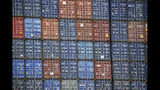 FILE - In this June 19, 2019, file photo cargo containers are stacked on a ship at the Port of Los Angeles in Los Angeles. Manufacturers see the Trump administration's trade policies as a bigger challenge than the economy. That's one of the findings of a quarterly survey by the National Association of Manufacturers, or NAM, released last week. (AP Photo/Marcio Jose Sanchez, File)