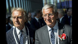 Alitalia President Luca cordero di Montezemolo, left, and former Italian soccer player and coach Marcello Lippi, right, arrive during the first day of the 134th Session of the International Olympic Committee (IOC), at the SwissTech Convention Centre, in Lausanne, Switzerland, Monday, June 24, 2019. The host city of the 2026 Olympic Winter Games will be decided during the134th IOC Session. Stockholm-Are in Sweden and Milan-Cortina in Italy are the two candidate cities for the Olympic Winter Games 2026. (Jean-Christophe Bott/Keystone via AP)