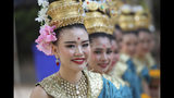 Thai tradition dancers prepare before a religious ceremony near the Tham Luang cave in Mae Sai, Chiang Rai province, Thailand Monday, June 24, 2019. The 12 boys and their coach attended a Buddhist merit-making ceremony at the Tham Luang to commemorate the one-year anniversary of their ordeal that saw them trapped in a flooded cave for more than two weeks. (AP Photo/Sakchai Lalit)