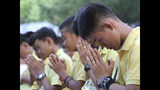 Members of the Wild Boars soccer team who were rescued from a flooded cave, pray during a religious ceremony near the Tham Luang cave in Mae Sai, Chiang Rai province, Thailand Monday, June 24, 2019. The 12 boys and their coach attended a Buddhist merit-making ceremony at the Tham Luang to commemorate the one-year anniversary of their ordeal that saw them trapped in a flooded cave for more than two weeks. (AP photo/Sakchai Lalit)