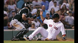 Boston Red Sox's Michael Chavis, right, beats the throw and a tag by Chicago White Sox catcher James McCann, left, to score on a single by Eduardo Nunez during the eighth inning of a baseball game at Fenway Park in Boston, Monday, June 24, 2019. (AP Photo/Charles Krupa)