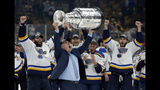 St. Louis Blues head coach Craig Berube carries the Stanley Cup after the Blues defeated the Boston Bruins in Game 7 of the NHL Stanley Cup Final, Wednesday, June 12, 2019, in Boston. (AP Photo/Michael Dwyer)