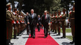 Secretary of State Mike Pompeo, center left, walks with Afghan President Ashraf Ghani's Chief of Staff Abdul Salam Rahimi, as he arrives at the Presidential Palace in Kabul, Afghanistan, Tuesday, June 25, 2019, during an unannounced visit. (AP Photo/Jacquelyn Martin, Pool)