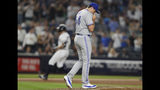 Toronto Blue Jays relief pitcher Derek Law, foreground, reacts on the mound after allowing a three-run home run to New York Yankees' Giancarlo Stanton during the sixth inning of a baseball game, Monday, June 24, 2019, in New York. (AP Photo/Kathy Willens)