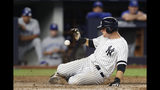 New York Yankees' DJ LeMahieu scores on Luke Voit's two-run double during the sixth inning of a baseball game against the Toronto Blue Jays, Monday, June 24, 2019, in New York. (AP Photo/Kathy Willens)