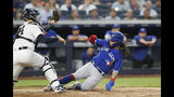 New York Yankees catcher Gary Sanchez, left, waits for the throw as Toronto Blue Jays' Freddy Galvis slides in to score on Eric Sogard's sacrifice fly during the sixth inning of a baseball game Tuesday, June 25, 2019, in New York. (AP Photo/Kathy Willens)