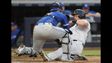 Toronto Blue Jays' catcher Danny Jansen, left, tags out New York Yankees' Luke Voit at the plate during the fourth inning of a baseball game Tuesday, June 25, 2019, in New York. (AP Photo/Kathy Willens)