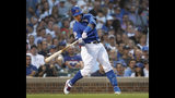 Chicago Cubs' Willson Contreras hits a two-run double off Atlanta Braves starting pitcher Max Fried during the fourth inning of a baseball game, Tuesday, June 25, 2019, in Chicago. Anthony Rizzo and Javier Baez scored on the play. (AP Photo/Charles Rex Arbogast)
