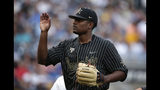 Vanderbilt pitcher Kumar Rockeer (80) walks off the mound in the second inning against Michigan in Game 2 of the NCAA College World Series baseball finals in Omaha, Neb., Tuesday, June 25, 2019. (AP Photo/Nati Harnik)