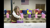 In this March 28, 2016 photo, Isabelle Meyer of Jasper, Ind. adds hand sanitizer to gift bags for chemotherapy patients during a meeting of Girl Scout Troop 670 in Cannelton, Ind. Isabelle, 11, was killed Monday, June 24, 2019, when a tree fell on her and three others during a Girl Scout camp at Camp Koch near Cannelton, Ind. (Sarah Ann Jump/The Herald via AP)