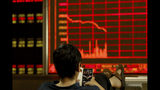 A man monitors stock prices at a brokerage in Beijing on Tuesday, June 25, 2019. Major Asian stock markets declined Tuesday as traders looked ahead to a meeting between the American and Chinese presidents amid hopes for renewed trade talks. (AP Photo/Ng Han Guan)