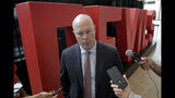 New Jersey Devils coach John Hynes, talks to reporters following a news conference introducing Jack Hughes, the No. 1 overall pick in the 2019 NHL hockey draft, Tuesday, June 25, 2019, in Newark, N.J. (AP Photo/Julio Cortez)