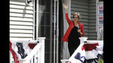 Democratic presidential candidate Sen. Elizabeth Warren, D-Mass., waves as she arrives at a campaign house party, Friday, June 14, 2019, in Windham, N.H. (AP Photo/Elise Amendola)