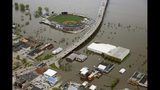 FILE - In this May 3, 2019 aerial file photo, the Modern Woodmen Park, top, and the surrounding of downtown Davenport, Iowa, are area covered by Mississippi River floodwaters. The prolonged flooding along the Mississippi River will cost more than $2 billion in repairs and cleanup, the Mississippi River Cities and Towns Initiative, and advocacy group for river communities, said Tuesday, June 25, 2019. (Kevin E. Schmidt/Quad City Times via AP, File)