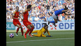 Italy's Elisa Bartoli, right, jumps over China goalkeeper Peng Shimeng, second right, just before Italy's Valentina Giacinti scored the opening goal during the Women's World Cup round of 16 soccer match between Italy and China at Stade de la Mosson in Montpellier, France, Tuesday, June 25, 2019. (AP Photo/Claude Paris)