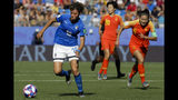 Italy's Valentina Giacinti, left, runs with the ball next to China defenders during the Women's World Cup round of 16 soccer match between Italy and China at Stade de la Mosson in Montpellier, France, Tuesday, June 25, 2019. (AP Photo/Claude Paris)