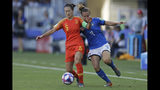 China's Wu Haiyan, left, vies for the ball with Italy's Aurora Galli during the Women's World Cup round of 16 soccer match between Italy and China at Stade de la Mosson in Montpellier, France, Tuesday, June 25, 2019. (AP Photo/Claude Paris)