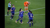 Japan's Yui Hasegawa, centre, is congratulated by teammates after scoring her team's first goal during the Women's World Cup round of 16 soccer match between the Netherlands and Japan at Roazhon Park, in Rennes, France, Tuesday, June 25, 2019. (AP Photo/Francois Mori)