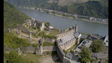 FILE - In this May 19, 2019 file photo, Rheinfels Castle is pictured in St. Goar, Germany. A descendant of the last German kaiser has lost a court bid for the return of the castle overlooking the Rhine valley, part of which has been turned into a hotel. Rheinfels Castle, high above the Rhine and once a property of the Hohenzollern family, has been owned by the town of St. Goar since 1924. (Thomas Frey/dpa via AP)
