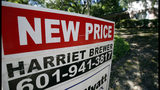 "In this June 13, 2019, photo a house on the market has a ""new price"" sign fixed on the realtor's sign in northeast Jackson, Miss. On Tuesday, June 25, the Standard & Poor's/Case-Shiller 20-city home price index for April is released. (AP Photo/Rogelio V. Solis)"