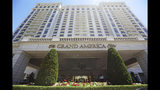 This Sunday, June 23, 2019, photo shows the Grand America Hotel, in Salt Lake City. A lawsuit filed Tuesday, accuses the luxury Grand America Hotel in Salt Lake City of luring workers from the Philippines to a program that promised training and cultural immersion but instead forced them to work long hours doing menial jobs for low pay. (AP Photo/Rick Bowmer)