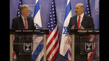 Israeli Prime Minister Benjamin Netanyahu, right, U.S. National Security Advisor John Bolton give statements to media in Jerusalem, Sunday, June 23, 2019. (AP Photo/Tsafrir Abayov, Pool)