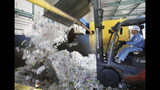 In this June 18, 2019, photo, a plastic recycling company worker adds used plastic bottles into bale breaker for processing, at Tokyo Petbottle Recycle Co., Ltd, in Tokyo. Japan has a plastic problem. Single bananas here are sometimes wrapped in plastic. So are individual pieces of vegetables, fruit, pastries, pens and cosmetics. Plastic-wrapped plastic spoons come with every ice cream cup. But as world leaders descend on Osaka for the two-day G20 Summit that starts Friday, June 28, Japan has ambitions to become a world leader in reducing plastic waste. (AP Photo/Koji Sasahara)