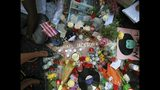 FILE - This June 26, 2009 file photo shows a sidewalk shrine of mementos, flowers and candles adorning the star of Michael Jackson on the Hollywood Walk of Fame in Los Angeles. Tuesday, June 25, 2019, marks the tenth anniversary of Jackson's death. (AP Photo/Reed Saxon, File)