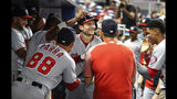 Washington Nationals' Trea Turner, center, is congratulated by teammates after Turner hit a three-run home run during the fourth inning of the team's baseball game against the Miami Marlins, Tuesday, June 25, 2019, in Miami. (AP Photo/Wilfredo Lee)