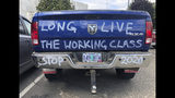 FILE - In this June 20, 2019, file photo, a diesel truck that belongs to a self-employed logger is parked in Salem, Ore. The divide in Oregon between the state's liberal, urban population centers and its conservative and economically depressed rural areas has made it fertile ground for the political crisis unfolding over a push by Democrats to enact sweeping climate legislation. Just three years after armed militia members took over a national wildlife refuge in southeastern Oregon, some of the same groups are now seizing on a walkout by Oregon's GOP senators to broadcast their anti-establishment message. (AP Photo/Gillian Flaccus, File)